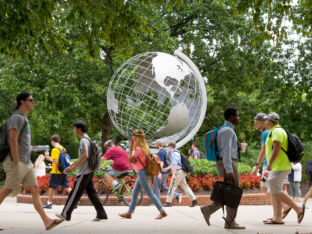 A group of students walking past The Globe on the Marietta Campus.
