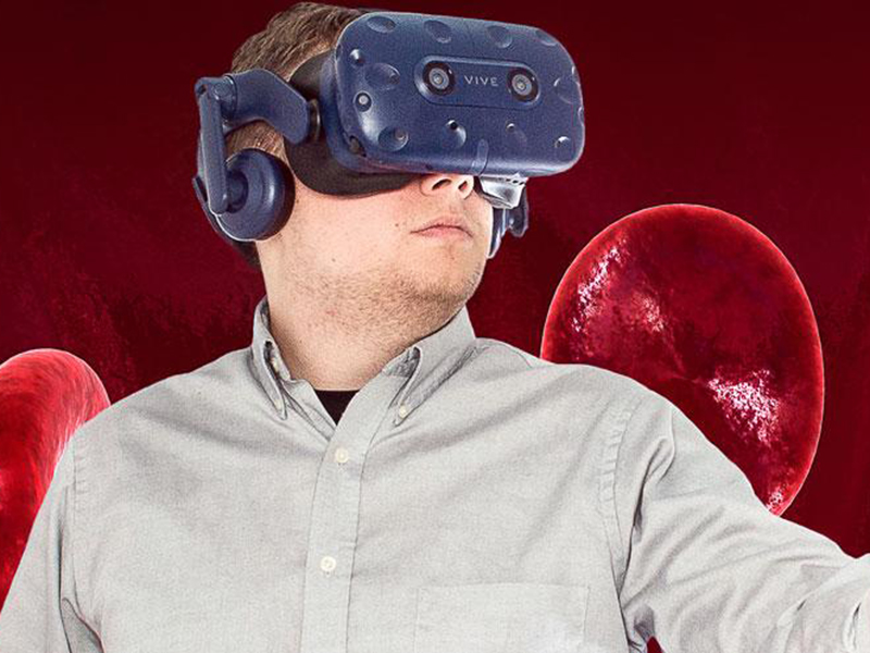 A man using virtual reality goggles.