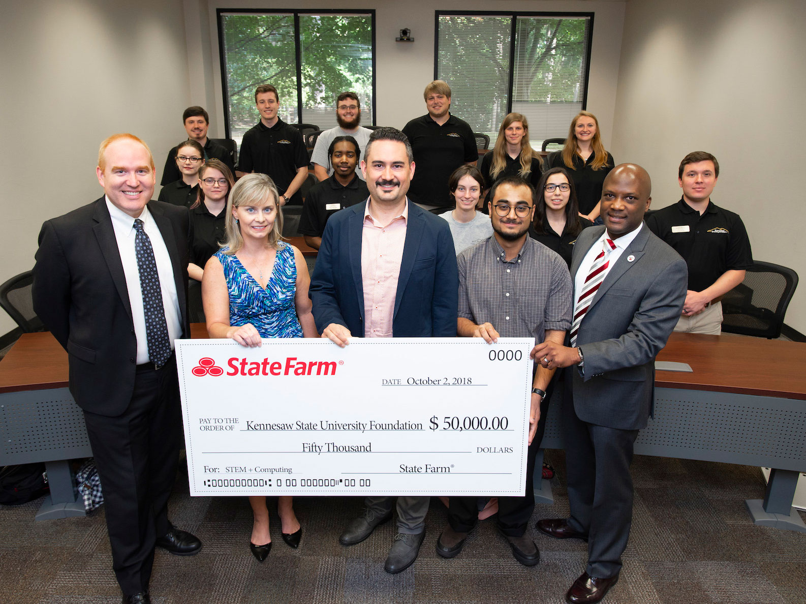 CCSE faculty and students gather to pose with State Farm grant.