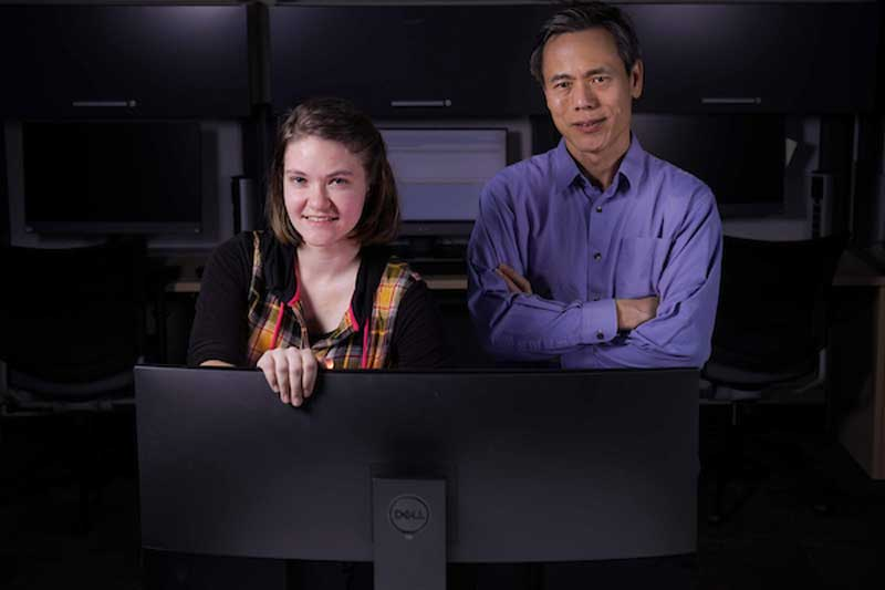 Ruth Bearden and Dr. Dan Lo posing in the computer lab.