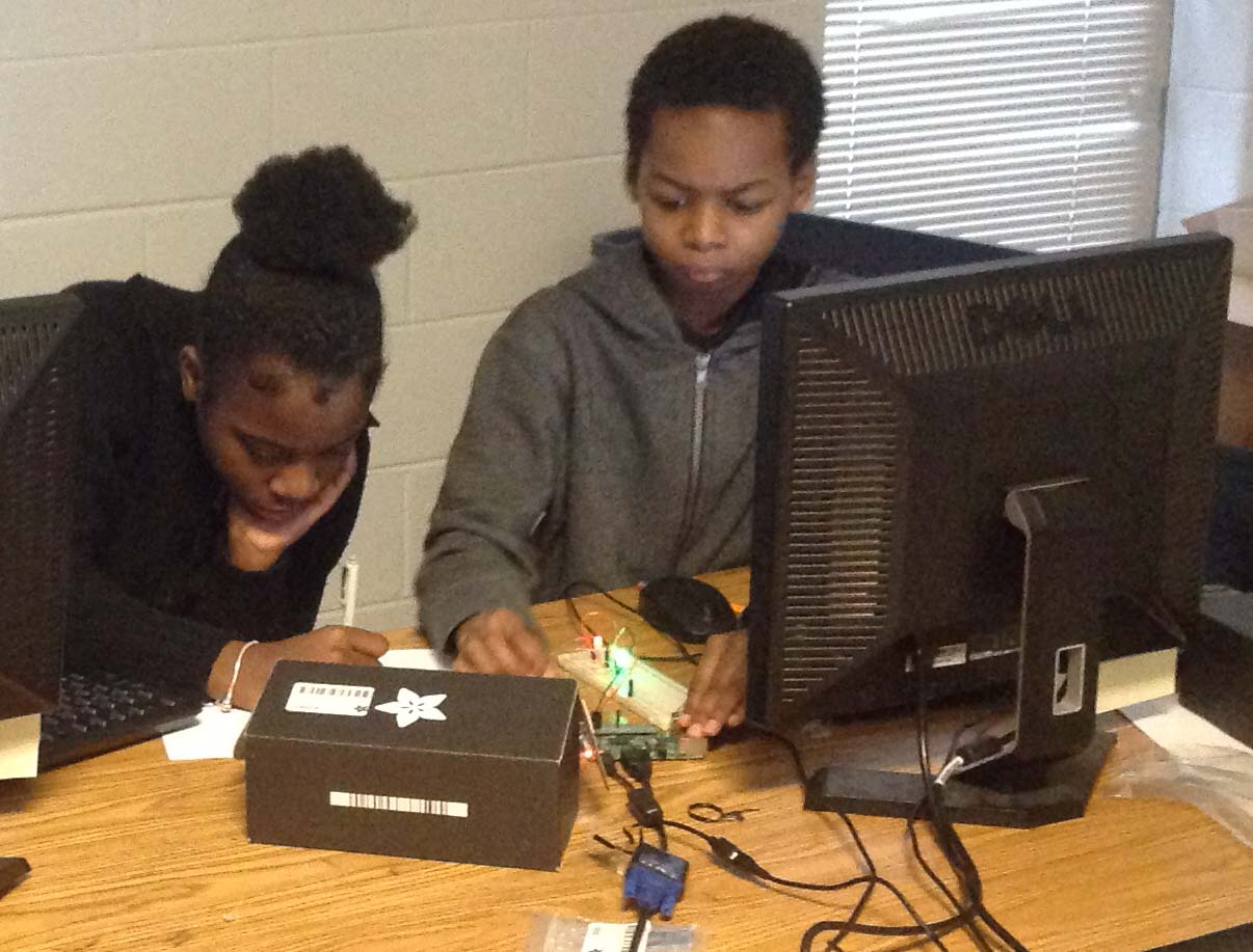Middle school students working with a Raspberry Pi